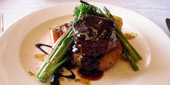 Peppered grilled elk medallion with red wine sauce